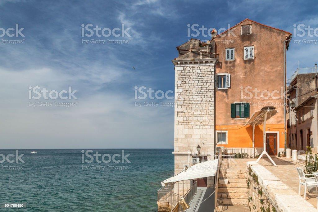 Historic buildings on the coast of Rovinj town on Adriatic sea. royalty-free stock photo