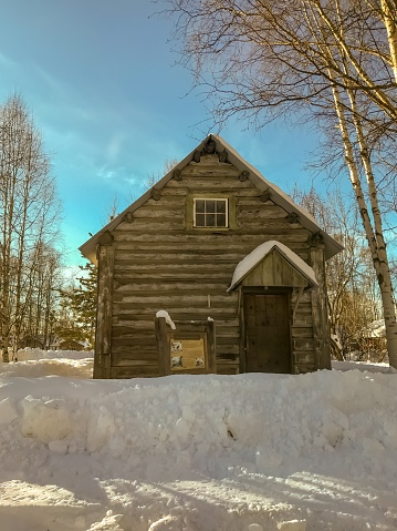A view from the road shows an old cabin.  This cabin has stood the test of time and many harsh winters.
