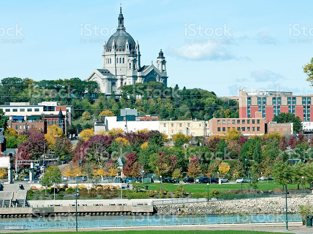Historic Cathedral of Saint Paul across Mississippi River in Minnesota stock photo