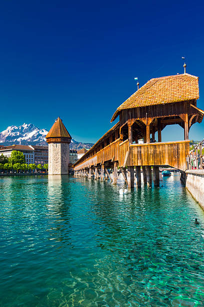 historic city center of lucern with chapel bridge - lucerne stock pictures, royalty-free photos & images