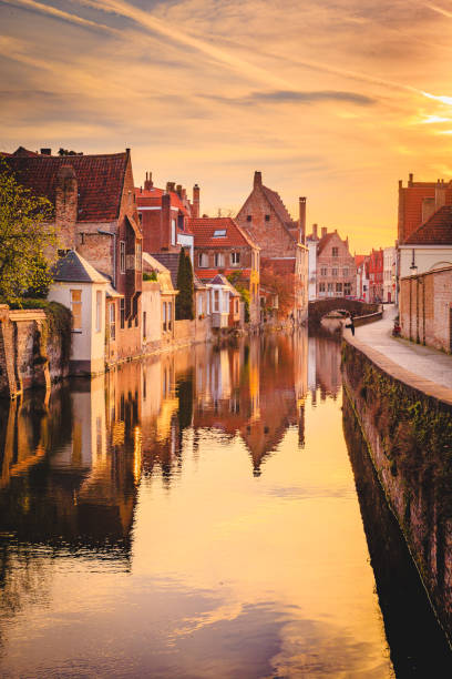 Historic city of Brugge at sunrise, Flanders, Belgium Scenic view of the historic city center of Brugge in beautiful golden morning light at sunrise, province of West Flanders, Belgium belgium stock pictures, royalty-free photos & images