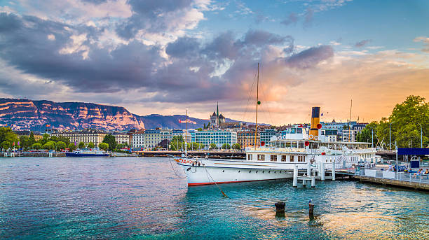 historic city of geneva with paddle steamer at sunset, switzerland - lake geneva stock photos and pictures