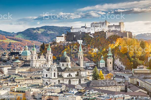 Aerial view of the historic city of Salzburg with Hohensalzburg Fortress in beautiful evening light in fall, Salzburger Land, Austria.