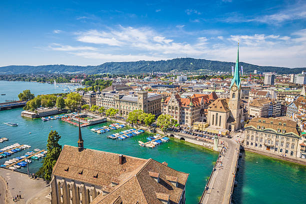 Historic city of Zürich with river Limmat, Switzerland Aerial view of Zürich city center with famous Fraumünster Church and river Limmat at Lake Zurich from Grossmünster Church, Canton of Zürich, Switzerland. fraumunster stock pictures, royalty-free photos & images