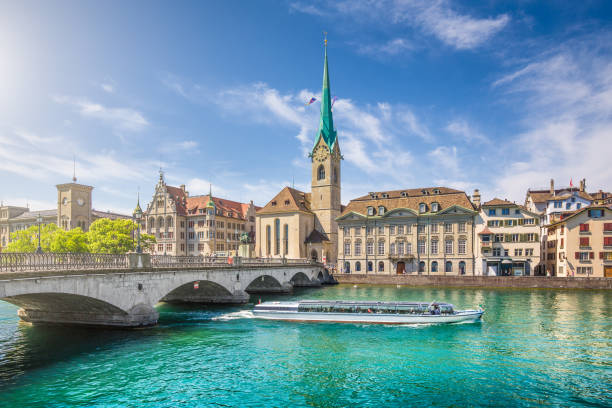 Historic city of Zurich with river Limmat, Switzerland Historic city center of Zurich with famous Fraumunster Church and excursion boat on river Limmat, Canton of Zurich, Switzerland zurich stock pictures, royalty-free photos & images