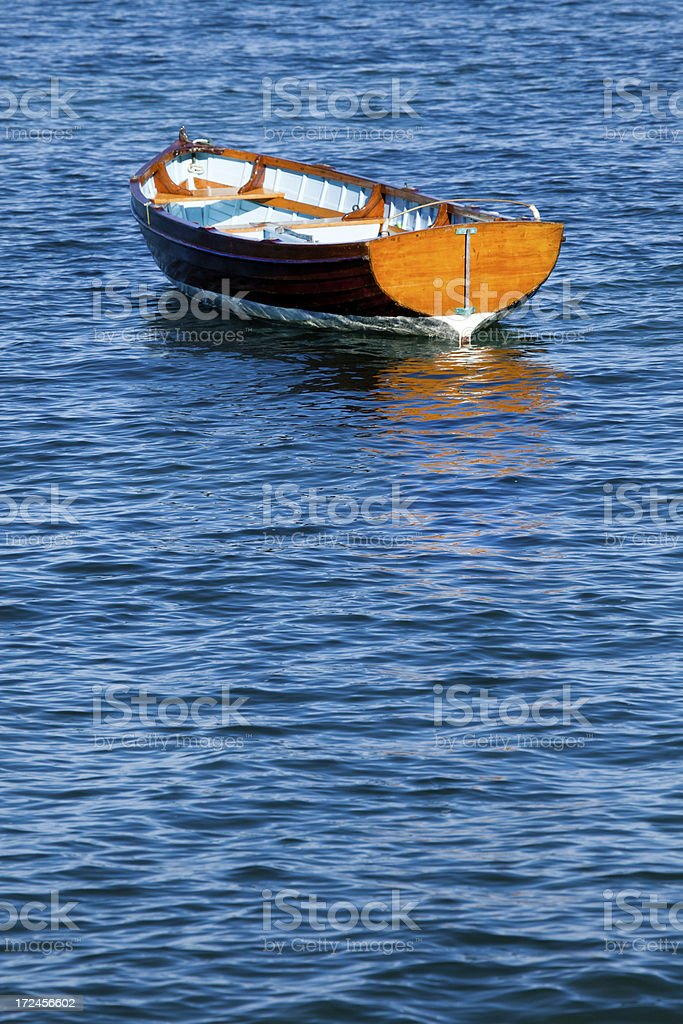 historic classic clinker wooden boat at anchor,Nelson,New Zealand royalty-free stock photo
