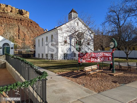 Historic community center with Christmas greetings in Rockville Utah with red rocks of Mesa in Zion National park Utah in the background