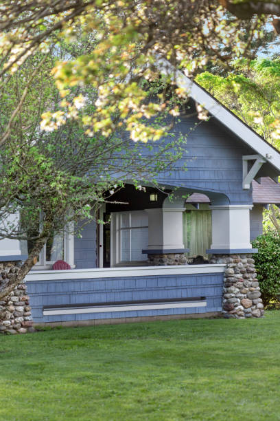 Historic Craftsman House, front view with river-rock pillars and large front porch. stock photo