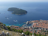 Dubrovnik, Croatia - August 4 2018: tourists looking out over panorama view of old town histoic unesco monument from viewing platform