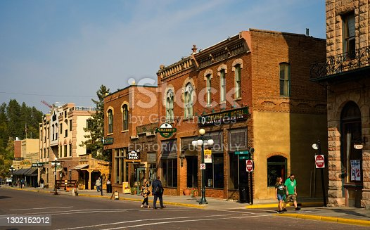 Deadwood, SD, USA - September 15, 2020: Old hotels, saloons, and other attractions bring visitors to historic Main St. in this Black Hills gold rush town, famous for outlaws and colorful characters.