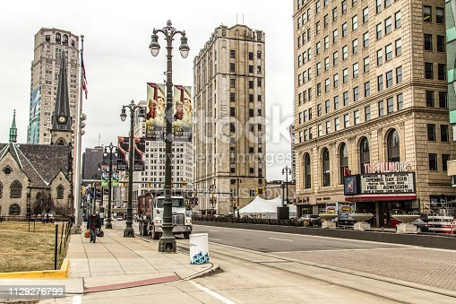Detroit, Michigan, USA - March 28, 2018: Downtown Detroit Michigan cityscape and streets of the Grand Circus Park neighborhood of Detroit. This area includes Comerica Park, Ford Field, Little Caesars Arena and Fox Theater.