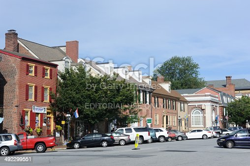 New Castle, USA - August 25, 2013. A man walking behind parked cars in Downtown area of the historic city of New Castle in Delaware. Founded in 1640, New Castle was the landing place of William Penn. It is about 10 minutes south of the city of Wilmington with a population of just over 5,000.