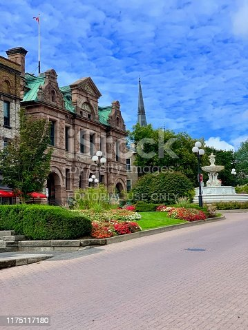 Brockville, Ontario, Canada - September 7, 2019: Some architectural elements on Court House Avenue include the John H. Fulford Fountain built in 1917 boasts Italian Renaissance features and the historic Thomas Fuller Building which serves as a Service Canada location today.