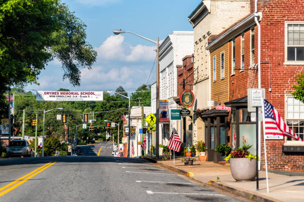 Historic downtown town city in Virginia countryside with brick buildings American flag on street stock photo
