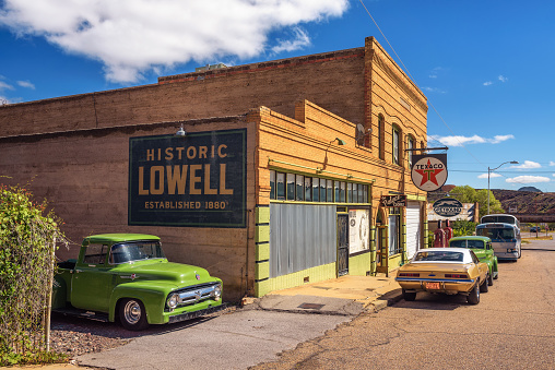 Lowell, Arizona, USA - October 17, 2018 : Historic Erie street with a vintage 1956 Ford F-100 car in Lowell. This ghost town situated on the other side of the Lavender Pit Mine is now part of Bisbee.