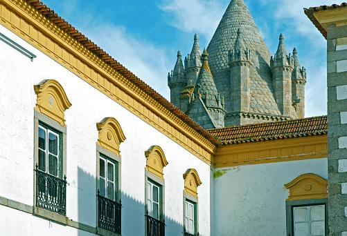 Historic Evora Cathedral beyond walls of university in Evora, Portugal