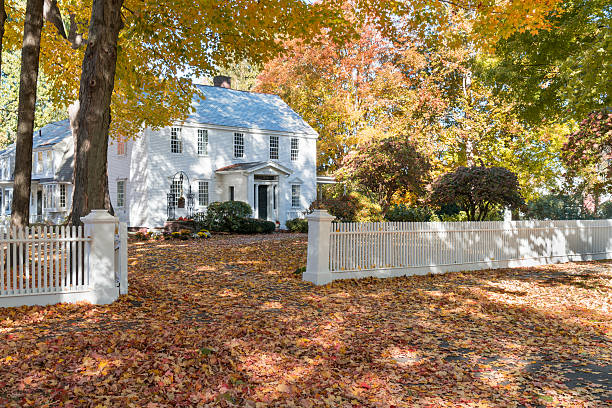 Historic Federal  Home Historic federal style home with a white picket fence in Deerfield, Massachusetts. colonial style stock pictures, royalty-free photos & images