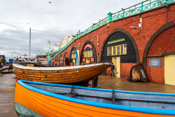 Historic fishing boats outside of the Fishing Museum on Brighton Beach. stock photo