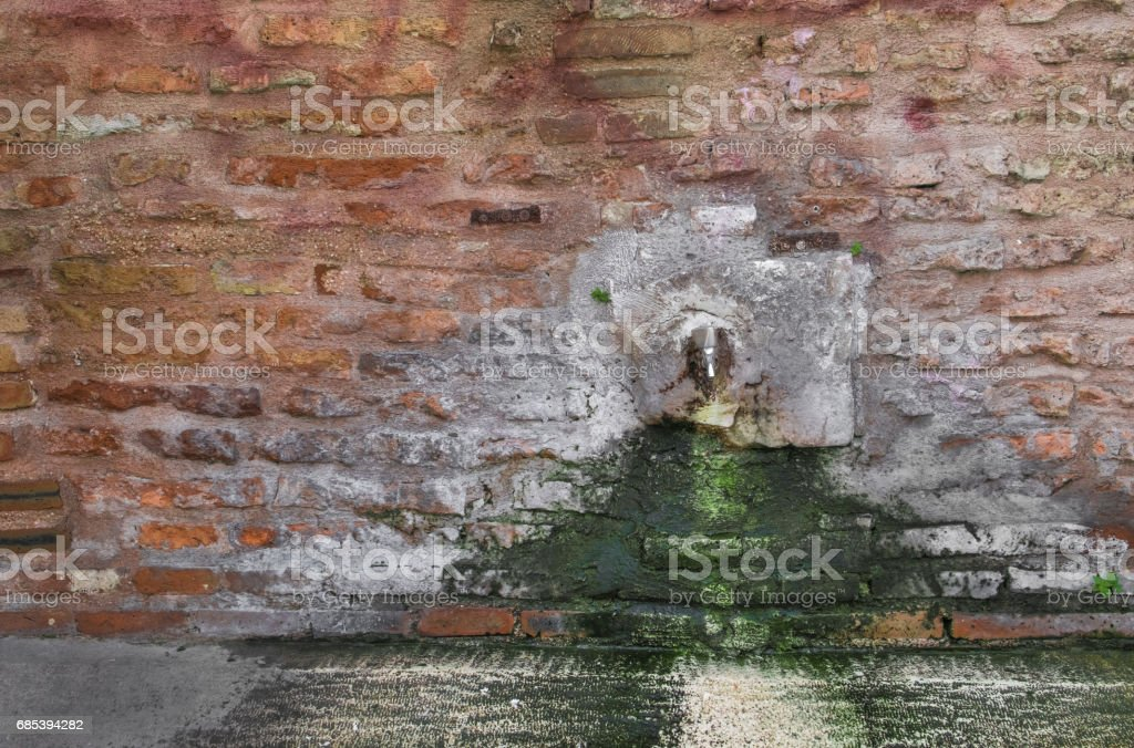 historic fountain, drinking fountain, old wall royalty-free stock photo