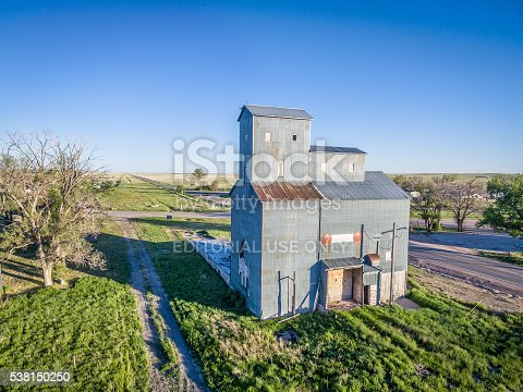 Grover, CO, USA - June 4, 2016:  Historic Grover Grain Elevator (circa 1916),  a well-preserved example of cribbed construction  in the Pawnee Grassland Region.  The railroad right-of-way is still visible next to it (dismounted in 1975).