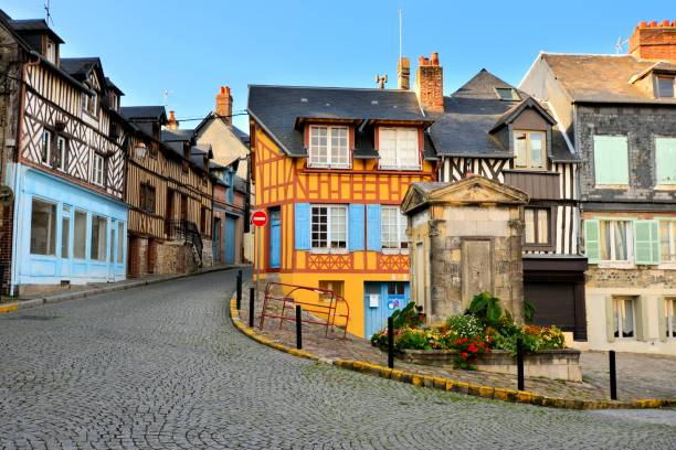 Historic half timbered buildings in Honfleur, France Historic half timbered buildings in the beautiful town of Honfleur, France calvados stock pictures, royalty-free photos & images