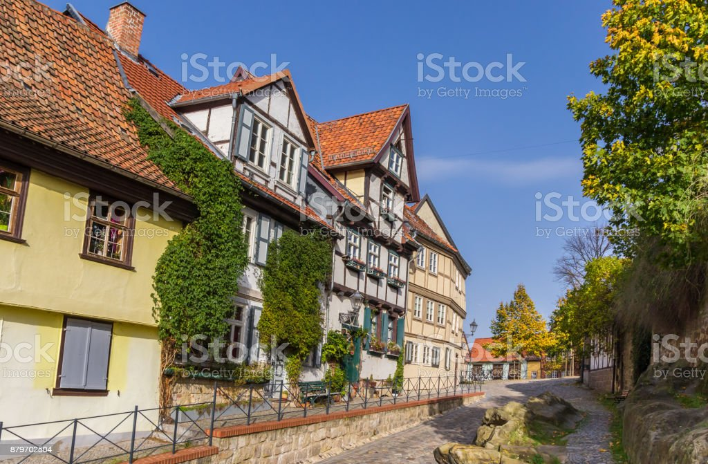 Historic houses at a rocky road in Quedlinburg, Germany stock photo