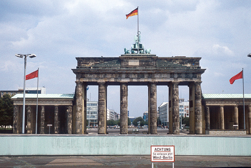 Historic image from July 1980: A look from West Berlin over the Berlin wall to Brandenburg Gate and East Berlin. Sign with