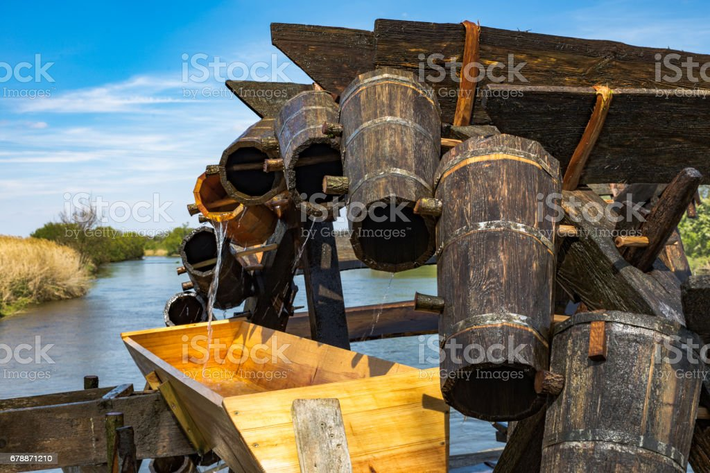 historic irrigation wheel with wooden buckets stock photo