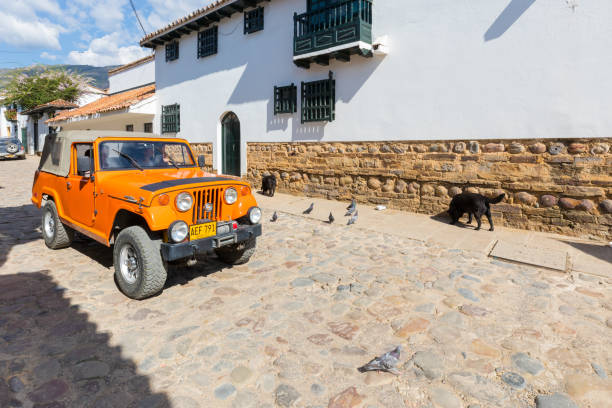 Historic jeep called Willy in the historic center of Villa de Leyva Colombia Villa de Leyva February 2018 This type of jeep supplied to the American army has been converted by the Colombians in the middle of work suitable for the streets of the cafe hills of the area. willys stock pictures, royalty-free photos & images