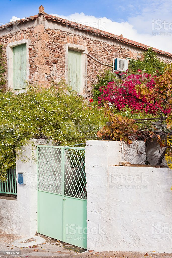 Historic mediterranean home with flower garden royalty-free stock photo
