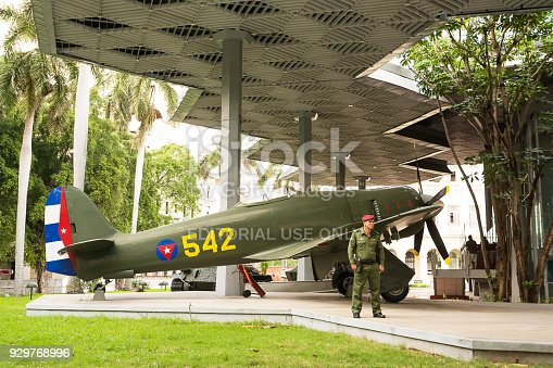 Havana, Cuba - December 10, 2017: Historic military plane with guard soldier