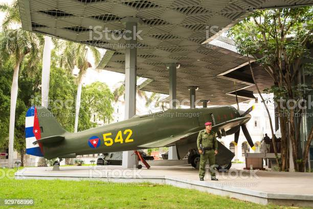 Historic military plane with guard soldier