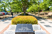 Atlanta, USA - April 20, 2018: Historic MLK Martin Luther King Jr National Park sign of walk of fame in Georgia downtown, green trees in urban city