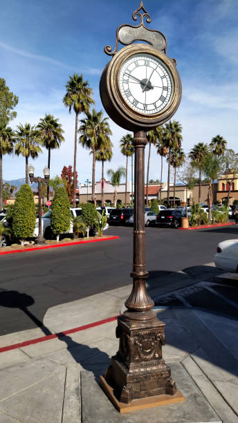 Historic old clock in Orange Street Plaza in downtown Redlands California Historic old clock in Orange Street Plaza in downtown Redlands California redlands california stock pictures, royalty-free photos & images