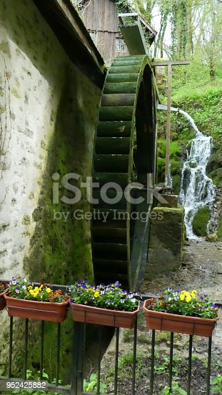 Historic old grist mill and flowers in the village of Chanaz France