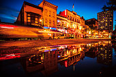 Historic Old World Third Street reflected in puddle.\nMilwaukee, Wisconsin, USA