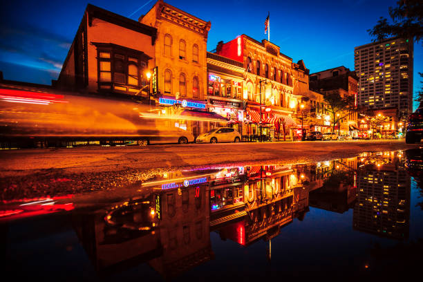 Historic Old World Third Street, Milwaukee Historic Old World Third Street reflected in puddle. Milwaukee, Wisconsin, USA milwaukee wisconsin stock pictures, royalty-free photos & images