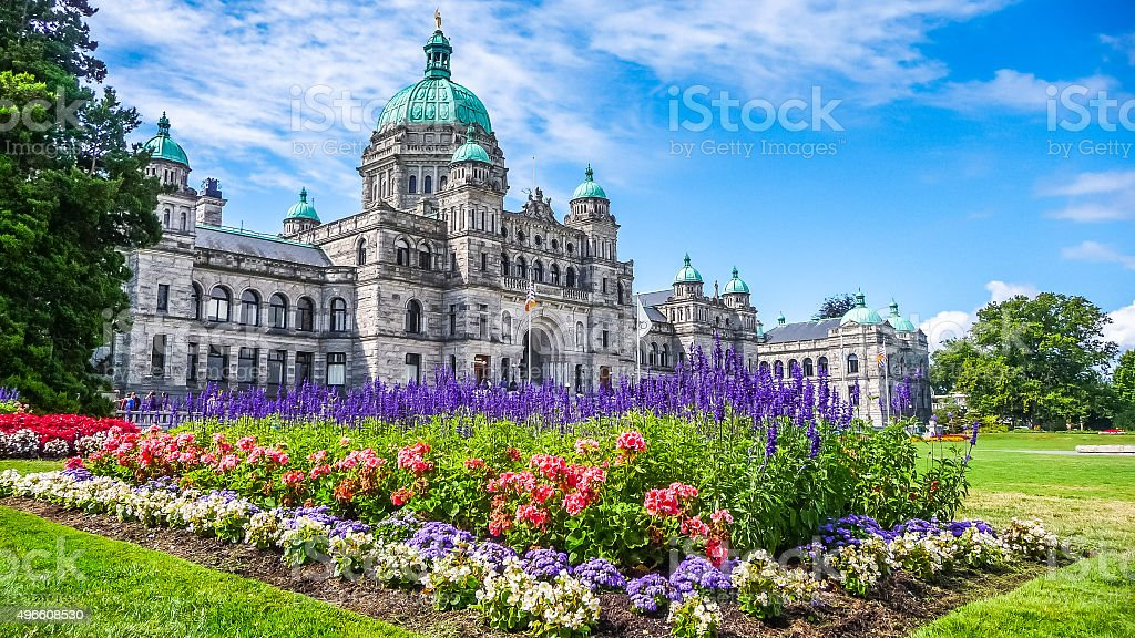 Historic parliament building in Victoria with colorful flowers, BC, Canada stock photo