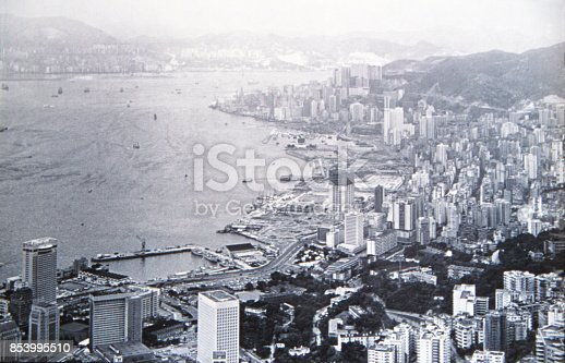 Historic photo of the British Colonial Hong Kong. Circa 1971. The view from Victoria Peak of the skyline of the island of Hong Kong, the Victoria Harbor and the Kowloon peninsula in the background.