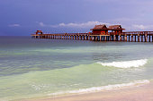 Historic pier on the Gulf of Mexico at Naples Florida is well known for its fishing, bird-watching, dolphin-spotting and its fabulous views of the sunset