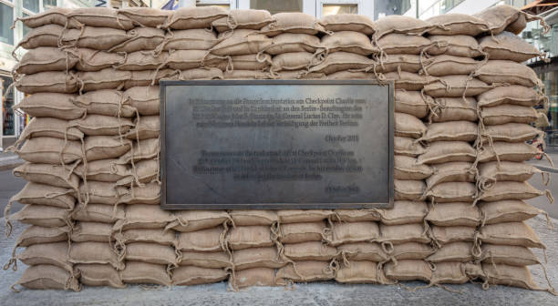 historic plaque, checkpoint charlie in berlin, germany - defection stock photos and pictures