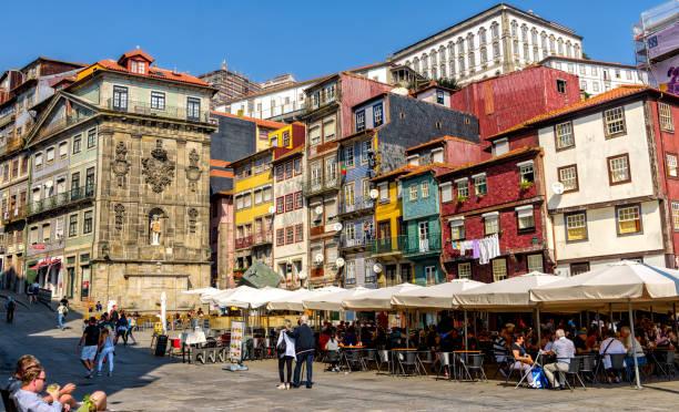 historic porto bars and restaurants in ribeira neighborhood attract tourists from all over the world. - esplanada portugal imagens e fotografias de stock