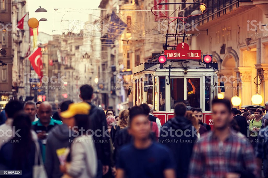Historic red tram on crowded Istiklal Avenue in Taksim, Istanbul stock photo