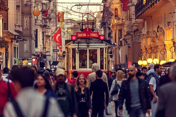 historic red tram on crowded istiklal avenue in taksim, istanbul - istiklal avenue bildbanksfoton och bilder