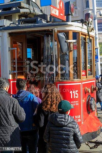 Istanbul, Turkey - Feb 1, 2019: Tramway passing through Istiklal street in Taksim, Beyoglu, Istanbul, Turkey.