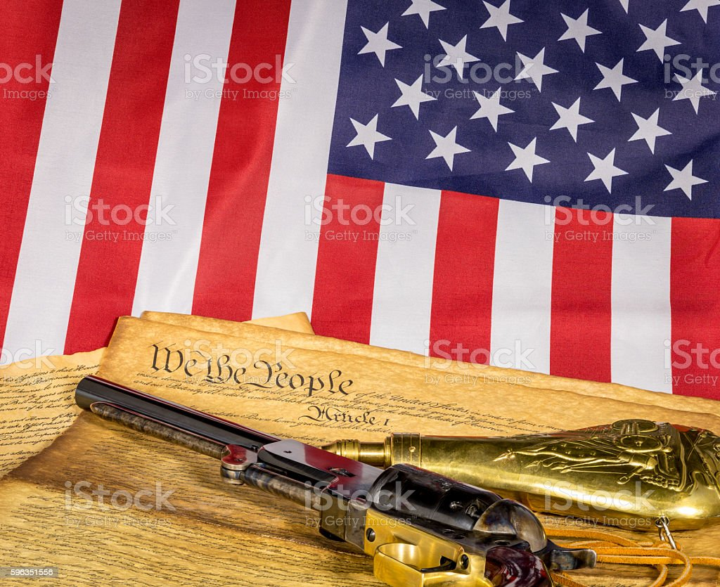 Historic revolver with constitution and American flag Lizenzfreies stock-foto