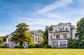 Historic ruin houses in classicist architecture style in spa town Heiligendamm, Germany