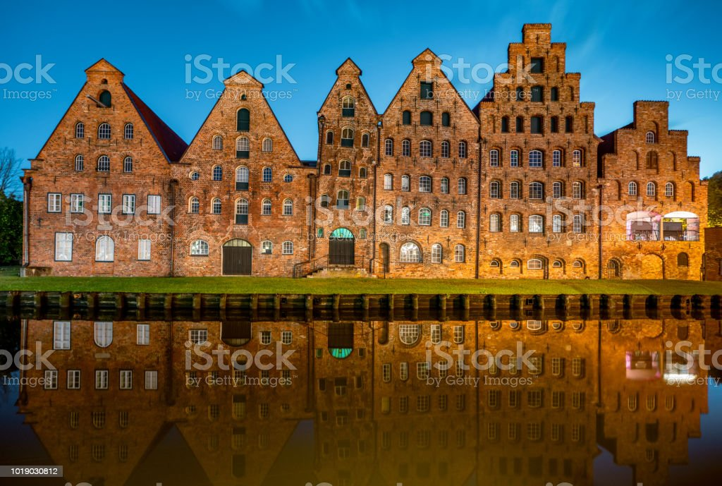 Historic Salt Storehouses Lübeck Brick Buildings Trave River at Night Lubeck Germany stock photo