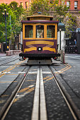 Classic view of historic Cable Car riding on famous California Street on a beautiful sunny day in summer, San Francisco, California, USA