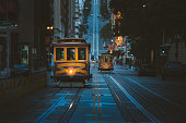 Magical twilight view of historic Cable Cars riding on famous California Street at dawn before sunrise, San Francisco, California, USA